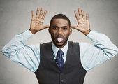 Executive man mocking someone — Stock Photo