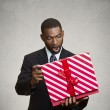 Man surprised with the gift he received — Stock Photo #50955275