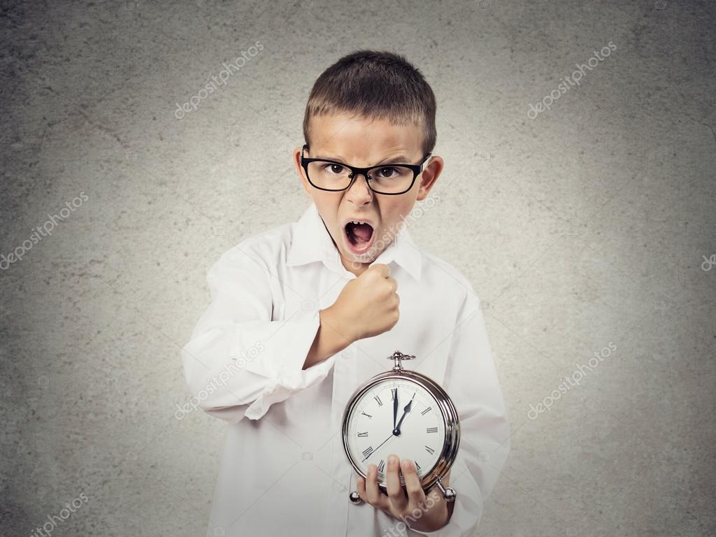 angry screaming child boy holding alarm clock stock. Black Bedroom Furniture Sets. Home Design Ideas