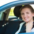 Woman pulling on seat belt inside her car — Stock Photo #51146549