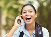 Laughing woman talking on a phone — Stock fotografie