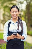 Happy business woman using smart phone — Foto Stock