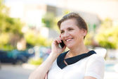 Happy Woman Talking on a Phone — Stock Photo