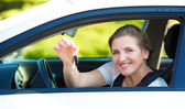 Happy woman showing  hew new car keys — Stock Photo