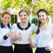Successful business women giving thumbs up — Stock Photo #51264381