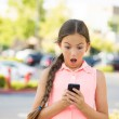 Shocked child texting on mobile, smart phone — Stock Photo #51264655