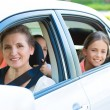 Happy family sitting in a car — Stock Photo