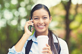 Happy woman talking on smart phone — Stock Photo