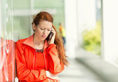 Unhappy woman on a phone — Stock Photo