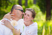 Happy mature couple enjoying weekend day in a park — Stock Photo