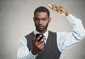 Busy executive holding smart phone — Stock Photo
