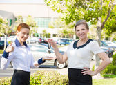 Apartment, car sale. Salesperson passing keys to customer — Stock Photo