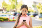 Shocked child texting on mobile, smart phone — Foto Stock