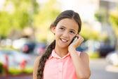 Happy girl talking on mobile, smart phone — Stock Photo