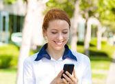 Happy woman texting on smart phone — Stock Photo
