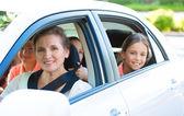 Happy family sitting in a car — Stock fotografie
