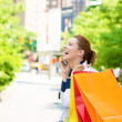 Happy shopping woman talking on a phone in Manhattan NYC — Stock Photo #51627883