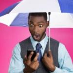 Man reading news on phone holding umbrella — Stock Photo #51629615