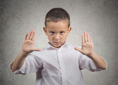 Boy giving stop gesture with hands — Stock Photo