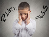 Stressed child, having headache — 图库照片