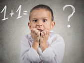 Confused, anxious boy trying to solve math problem — Stock Photo