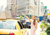 Happy woman hailing taxi cab in Manhattan  New York city — Stock Photo
