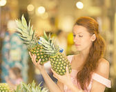 Woman shopping in supermarket, fruit section — Stock Photo