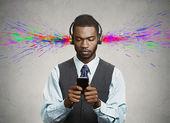 Businessman listening music on his smart phone — Stock Photo