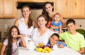 Happy family ready to have breakfast — Stock Photo