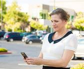 Woman reading something on smart phone — Stock Photo