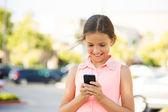 Happy girl checking her new smart phone — Stock Photo
