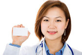 Doctor is holding a blank business card. — Stock Photo