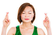 Woman crossing fingers hoping for the best. — Stock Photo
