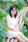 Girl in lotus lake — Stock Photo