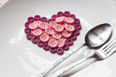 Buttons in shape of heart — Stock Photo