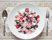 Dish of buttons — Stock Photo