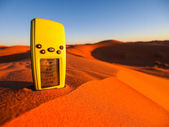 GPS navigator on sand dunes — Stock Photo