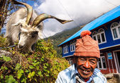 Unidentified man with goat — Stock Photo
