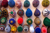 A variety of colored hats — Стоковое фото