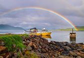 Rainbow over ship — Stock Photo