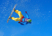 Snowboarder making jump — Stock Photo