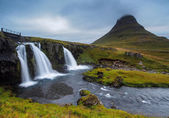 Kirkjufellsfoss waterfall and mountain — Stock Photo