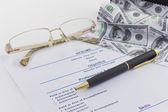 Glasses and pen lie on a resume — Stock Photo