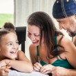 Dad, Mom and daughter homework — Stock Photo #47974607