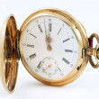 Pocket watch in a gold case on a white background, zoom — Stock Photo #48148641