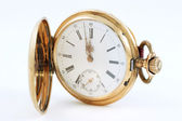 Pocket watch in a gold case on a white background, zoom — Stock Photo