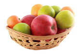 Coloured fruit in basket — Stock Photo