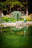Garden with lake and statues — Stock Photo