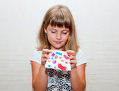 Girl with colored purse — Stockfoto