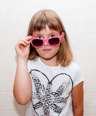 Girl with pink sunglasses — Stock Photo